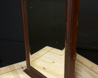 Vintage dark wood mirror.