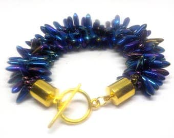 Chunky purple spiky beaded bracelet on a Kumihimo braid.