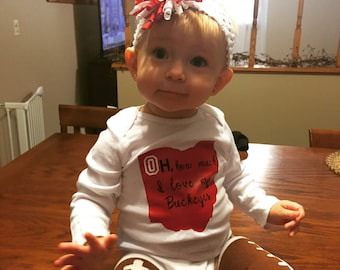 Your little Ohio State fan is going to look absolutely adorable in this onesie with an original saying!