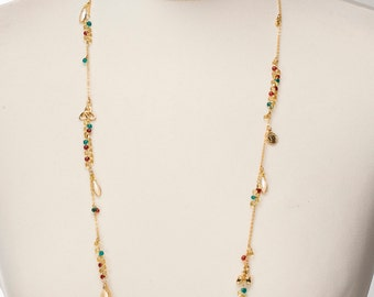 Beaded chain necklace with fancy ornamentals and small figgery