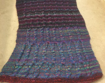 Multi-colored knit cabled afghan
