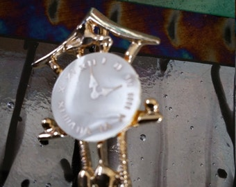 Clock pin with mother of pearl face