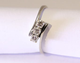 White Gold and triple Diamond Engagement Ring