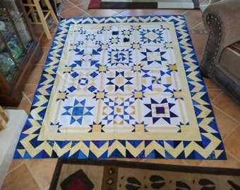 Scrappy quilt top blue yellow with white background quilt top