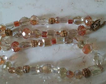Shining apricot and pale lemon crystal beads with gold metal bits 18""