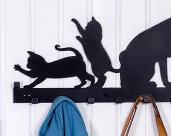 Designer clothes hanger with kittens