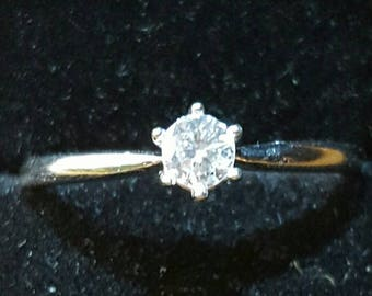 3.5mm white diamond and silver ring. Size 7.