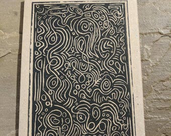 Swirls and circles pattern linocut black ink on recycled paper, greetings card.