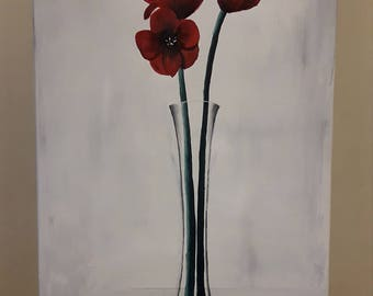 Red flowers in a tall vase