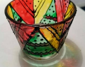 Glass painted candle holder. Arabic design