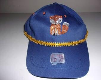 decorated baseball cap, navy blue