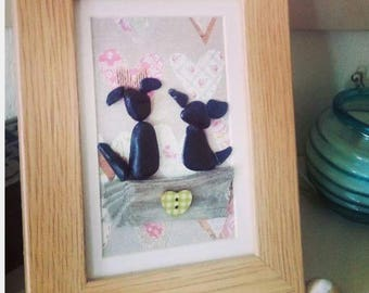 Floral dogs pebble art in frame