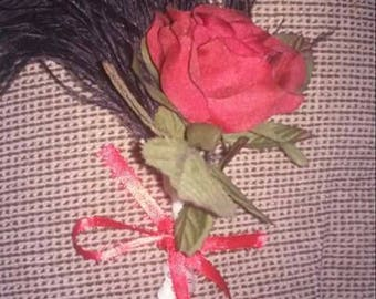 red rose and black feather boutineer