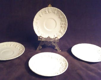Wedgewood Queensware,cream on cream,saucers only(4)  scalloped edge