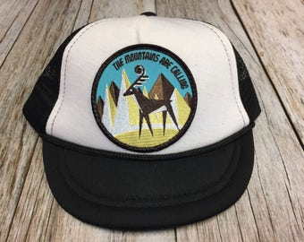 """Unisex Infant Trucker Hat with """"The Mountains are Calling"""" Patch 0-6 Months"""