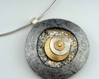 Triple Disc Polymer and Mixed Metals pendant on sterling neckwire