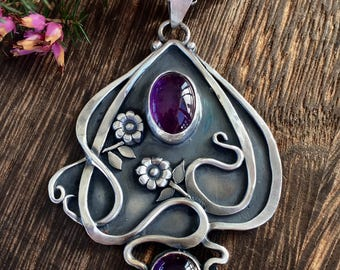 Art nouveau inspired, handmade, sterling silver, amethyst pendant and chain.