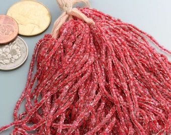 Vintage, almost antique! seed bead master hank. Pink-lined crystal. Made in Czecho-Slovakia. Imported by Natraco Quality.