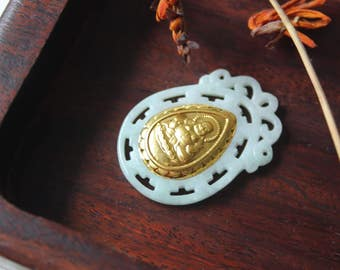 Vintage green jade pendant with gilded figure of Buddha