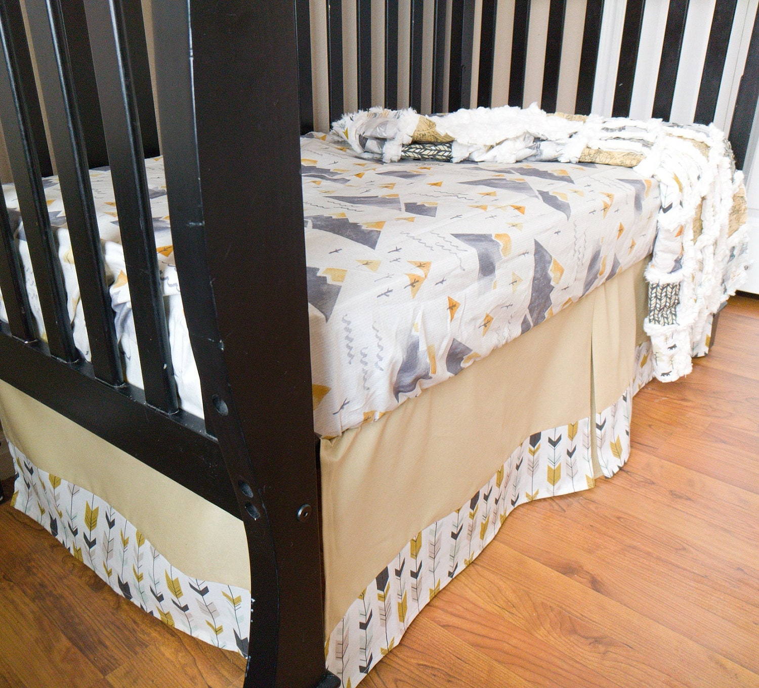 Tan adventure awaits crib set with arrow trim for Mountain crib bedding