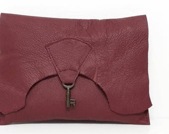 Raw edge leather clutch purse with vintage key detail - wine