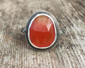 Oxydized sterling silver ring with freeform orange carnelian faceted cabochon