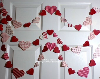 Red and White Heart Garland..9' of Hearts on Red and white Bakers Twine..Designer paper die cut...embossed die cut card stock hearts...
