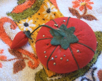 little red tomato pin cushion