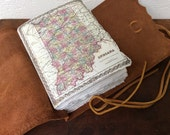 Hoosier love leather travel journal with classic leather wrap and handmade paper.