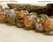 ON SALE 50% OFF Glass Lampwork Bead Set - Seven Light Pink w/Orange Floral Rondelle Beads 10801001