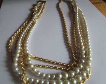 many strand pearl with gold chain