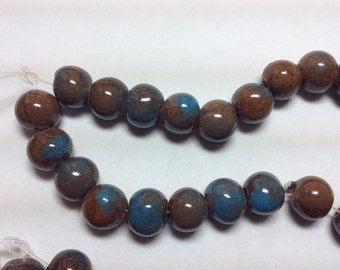 Ceramic Brown/blue beads (approx 33)