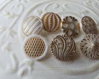 Vintage Buttons - lot of 7 milk glass hand painted medium size pressed glass gold accent designs. ( feb 531 17)