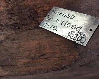 ahimsa - blackened brass passages plaque
