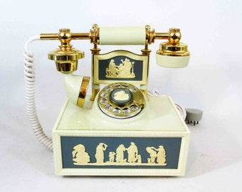 Vintage French Style Rotary Phone with Ivory Body and Brass Accents In Greek Motif. Circa 1970's.