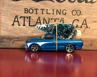 Blue 67 Chevy Truck Carrying Christmas Tree Ornament