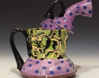 Purple polka dots and gold on green with black handles watering can
