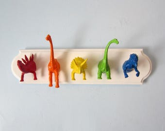 Upcycled Toy Wall Peg Rack with Dinosaur Rainbow Clothes Hooks