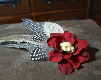 red flower and pheasant feather steampunk gothic hair clip with skull, blood and bone