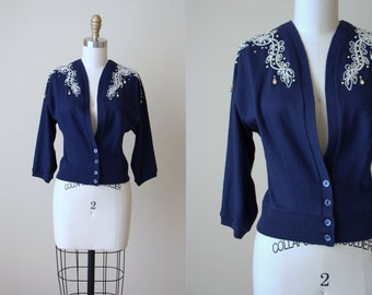 50s Sweater - Vintage 1950s Bombshell Navy Blue Wool Batwing Cardigan Soutache Rhinestones and Pearls L - The Glitz Sweater