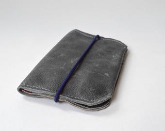 Wallet of grey leather with blue screenprint