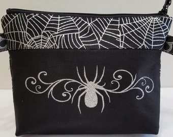 Can-Am Spyder zipper pouch in metalic black and silver fabric and silver glitter swirly spider