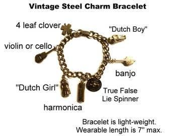 Vintage Charm Bracelet Silver Toned Steel Metal. 7 Charms, Harmonica, Dutch Boy & Girl, Banjo, Violin, 4 Leaf Clover and Articulated Spinner