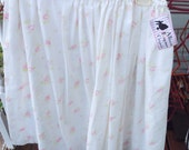 Handmade pink floral skirt with white background  Made from a vintage sheet.  One size. Handmade vintage. Floral sheet.