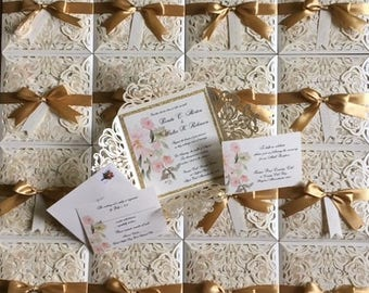 Put  a pretty bow on it!  Lacey laser wedding invitations