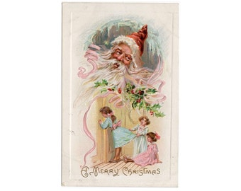 A MERRY CHRISTMAS - antique postcard - embossed holiday stationery - written on - used