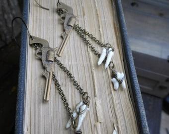 Doc Holliday, the gunslinger. Brass Pistol & genuine animal tooth earrings