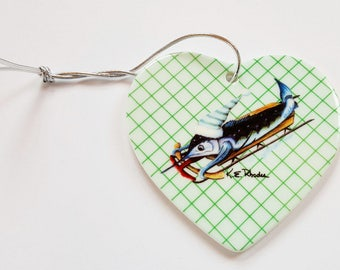 Marlin Sledding Winter Holiday Christmas ornament heart shaped porcelain ready to hang