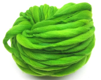 Super bulky handspun yarn, 41 yards and 2.45 ounces/ 70 grams, spun thick and thin in bright green merino wool