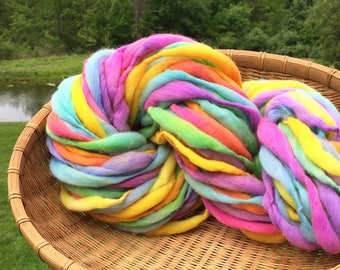 Super bulky handspun rainbow yarn, 55 yards and 2.9 ounces/ 82 grams, spun thick and thin in merino wool